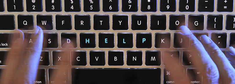 """Keyboard with the word """"help"""" highlighted."""
