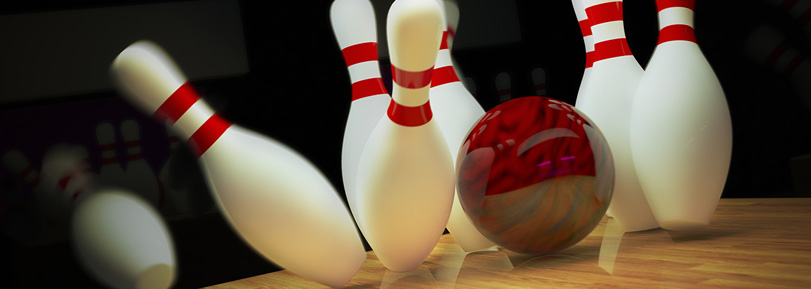 A red bowling ball hitting bowling pins.