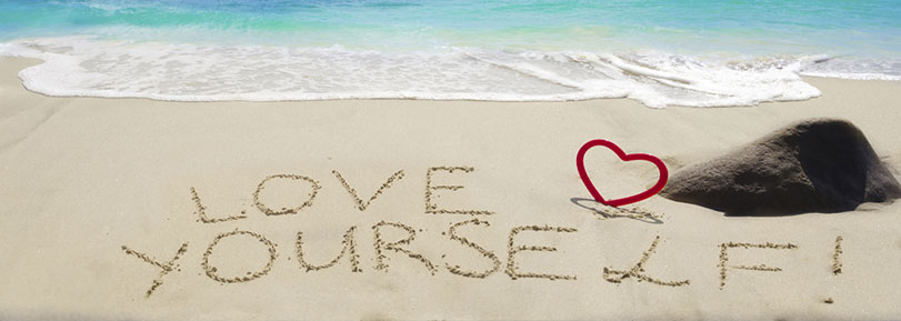 """""""Love Yourself"""", written in the sand."""