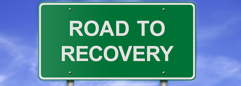 """Road sign that says, """"Road to Recovery""""."""