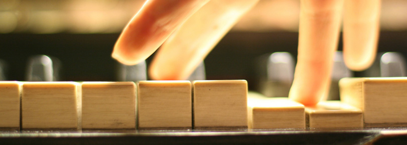 A hand playing the piano.